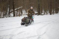 GOMEL, BELARUS - JANUARY 15, 2017: Winter fun. Family sledging hunting snowmobile. Royalty Free Stock Photo