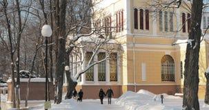 Gomel, Belarus - January 27, 2019: Young Couple People Walking In Snowy City Park Near Rumyantsev-Paskevich Palace In stock video