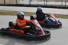 GOMEL, BELARUS - MARCH 8, 2010: Amateur competitions in races on karting track. organized recreation. Royalty Free Stock Images