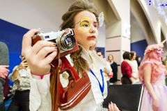 The girl with the camera. Cosplay character. Gomel, Belarus - March 24, 2018: International festival of hairdressers. The girl with the camera. Cosplay character Stock Photography