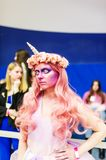 Hairstyle of the pink queen with horn. Cosplay character. Gomel, Belarus - March 24, 2018: International festival of hairdressers. Hairstyle of the pink queen Royalty Free Stock Photo