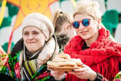 Women sell donuts at the festival. Gomel, Belarus royalty free stock photo
