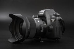 GOMEL, BELARUS - May 12, 2017: Canon 6d camera with lens on a black background. Canon is the world`s largest SLR camera manufactur. Er Royalty Free Stock Photos