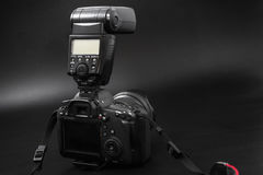 GOMEL, BELARUS - May 12, 2017: Canon 6d camera with lens on a black background. Canon is the world`s largest SLR camera manufactur. Er Royalty Free Stock Images