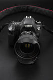 GOMEL, BELARUS - May 12, 2017: Canon 6d camera with lens on a black background. Canon is the world`s largest SLR camera manufactur. Er Stock Images