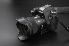 GOMEL, BELARUS - May 12, 2017: Canon 6d camera with lens on a black background. Canon is the world`s largest SLR camera manufactur. Er Royalty Free Stock Image
