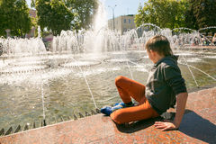 GOMEL, BELARUS - May 14, 2017: Children play with water near a city fountain in the city of Gomel Royalty Free Stock Photography