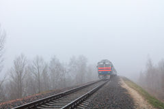 Gomel, Belarus - 24 November 2013: The suburban diesel train moves on rails. Royalty Free Stock Photography