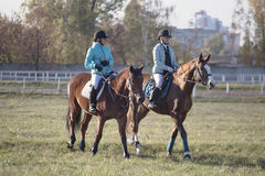 Gomel, Belarus - October 16, 2016: Two girls rider warm up the horses before the competition Royalty Free Stock Images