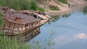 GOMEL, BELARUS old rusty metal river barge on the bay stock footage