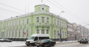 Gomel, Belarus. Gomel Region Main Department Of National Bank In Winter Snowy Snowstorm Day. Building At Intersection Of. Sovetskaya And Lange Streets. Pan stock footage