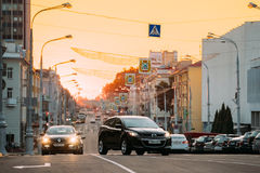 Gomel, Belarus. Traffic On Lenin Avenue On Yellow Sunset With Moving Stock Images