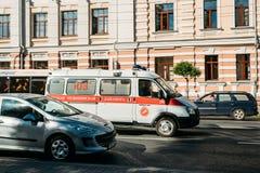 Gomel, Belarus. White Emergency Ambulance Van Car Moving On Sovetskaya Street Stock Image
