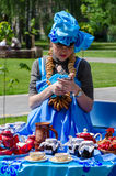 Gomel, City of Masters event. Girl with bagels around the neck l Royalty Free Stock Photo