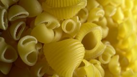 Various types dry pasta. Gomiti rigati dry pasta in rotation on a black background.Studio shot. Close Up stock video