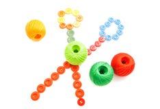 Gomitoli di filo e bottoni variopinti Fotografia Stock