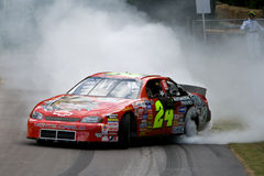 Gomma burning di Chevy Monte Carlo Fotografia Stock