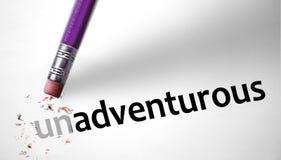 Gomma che cambia la parola Unadventurous per avventuroso immagine stock