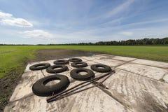 Gomme commutate per uguagliare campo agricolo irregolare Immagine Stock