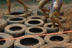 Gomme di funzionamento del fango Fotografia Stock