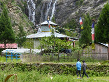 Gompa under Tal waterfalls royalty free stock photography