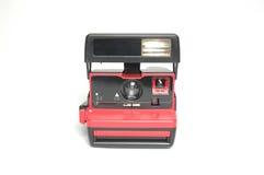Ögonblicklig filmkamera för tappning i röd färg Fotografering för Bildbyråer