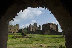 The gondar palace, through an arch ethiopia. The king's palace in gondar, through an arch,  ethiopia Royalty Free Stock Image