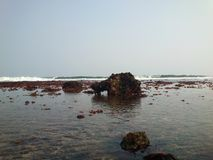 Gondo Mayit Beach Blitar. Gondo Mayit Beach at low tide full of corals. One of the most beautiful beach in Blitar district, East Java, Indonesia Stock Image