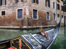 Gondola. Venetian gondola on the calm water of the channel Royalty Free Stock Image