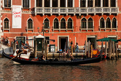 Gondola. Venice,Italy,July 29th 2011: Image of a gondola sailing at the sunset in front of a traditional building on The Grand Canal in Venice Italy.Venice is a Royalty Free Stock Image