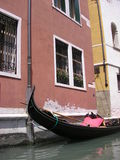 Gondola. A gondola boat parked near a building in a canal in Venice, Italy royalty free stock photos