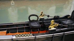 Gondola boat close-up. Gondola moored, Venice, Italy. Italian gondola paddle boat docked in Venice, Veneto, Italy stock footage