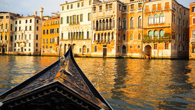 Gondola boat sail in Venice. This was taken when I ride gondola. There are colorful building in front of me stock photo