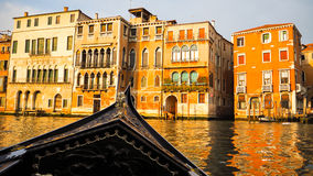 Gondola boat sail in Venice. This was taken when I ride gondola. There are colorful building in front of me stock photography