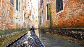 Gondola boat sail in Venice. This was taken when I ride gondola. There are colorful building in front of me royalty free stock photography