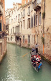 On Gondola boat of Venice. Riverside of Venice, with boats and Gondola Royalty Free Stock Images
