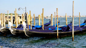 Gondola boats floating in the sea Venice Stock Photo