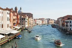 Gondola and Boats sails down the channel in Venice, Italy. Venice, Italy - October 26, 2017: Gondola and Boats sails down the channel in Venice, Italy Royalty Free Stock Photography