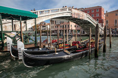Gondola boats stand at pier Royalty Free Stock Photography