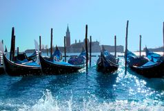 Gondola boats in Venice harbor stock photo