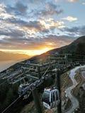 Gondola cable cars at sunset royalty free stock image