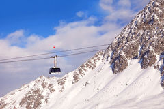Gondola on cable on mountain resort Stock Images