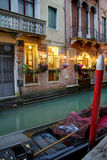 Gondola on Canal. Evening view of a gondola docked in a canal in Venice in the evening Royalty Free Stock Image