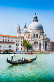Gondola on Canal Grande with Basilica di Santa Maria della Salute, Venice, Italy Stock Photo