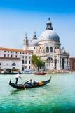 Gondola on Canal Grande with Basilica di Santa Maria della Salute, Venice, Italy Stock Photo