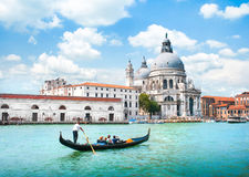 Gondola on Canal Grande with Basilica di Santa Maria della Salute, Venice, Italy Stock Photos