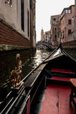 Gondola on a canal in Venice Stock Images