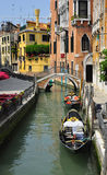 Gondola on the canal in venice, italy. Shot of a canal with boats and gondolas Stock Images