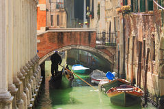 Gondola on canal in Venice, Italy. Stock Image