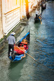 Gondola on canal in Venice, Italy Stock Images
